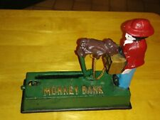 "Collector's Cast Iron Mechanical ""Monkey Grinder"" Penny Bank by Monogram Box"