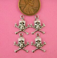 SM ANT SILVER SKULL AND CROSSBONES-- W/ RING- 4 PC(s)