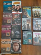 Lot of Seinfeld, Friends, and 13 Movies on DVD