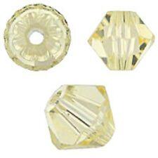 Genuine Swarovski Crystal Bicone. Jonquil Color. 3mm. Approx. 144 PCS. 5328