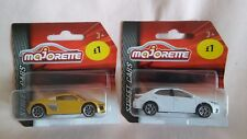 MAJORETTE X2 NEW OUT MODELS A WHITE TOYOTA COROLLA ALTIS AND A YELLOW AUDI R8.
