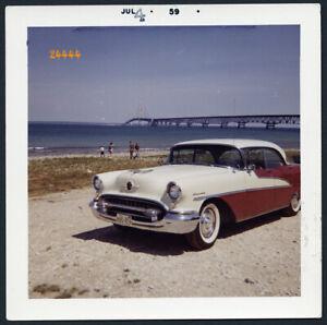 Mackinac bridge, classic car Oldsmobile Holiday Vintage Photograph, 1959