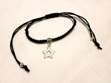 """Pulsera """" Trini"""" charm de estrella en color plata y cordón negro"""