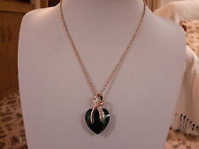 Brand new gold necklace with an emerald green crystal heart and gift box