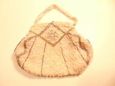 Small ivory or clam colored purse with beaded accents; made in Belgium