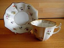 LATE 19TH EARLY 20TH CENTURY KPM BERLIN FLUTED PORCELAIN FLORAL CUP AND SAUCER