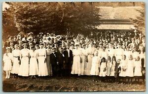 Arlington IA~Ladies, Boys & Tikes in Front~How Do You Like Shredding? RPPC 1909