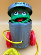 Fisher Price Vintage Oscar The Grouch #177 Squeeze Bulb/ Pop Up/ Pull Toy 1977
