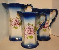 "Cobalt Flow Blue Pitchers Set of 3 Ceramic Pink Roses 9"", 7 1/4"",  6 1/2"" Tall"
