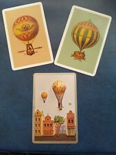 playing cards swap,  Three cards  Hot air  balloons.