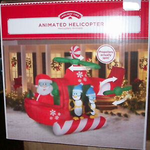 Gemmy 9 Ft  Airblown Inflatable Animated Helicopter with Santa & Penguins