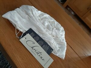 WHITE CHRISTINE HEADWEAR...NEW WITH TAGS...WITH ORIGINAL PACKAGE...