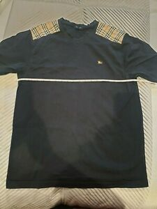 Burberry T-Shirt, Black with Burberry plaid on shoulders. GENUINE