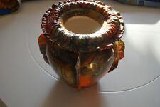 vase en céramique recouvert d'un tissu de fibre de verre, de résine et de vernis