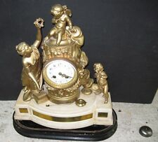 FRENCH FIGURE MANTLE CLOCK.  MARBLE BASE. 19TH CENTURY