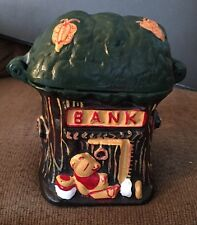 CAST IRON TREEHOUSE BANK WITH WINNIE THE POOH !