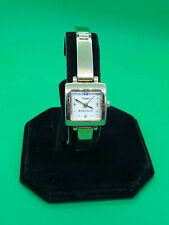 ladies timex essentials gold tone dress watch,white dial gold tone bracelet.b3.