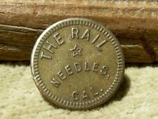"ca 1900 NEEDLES CALIFORNIA COLORADO RIV MOJAVE DESERT ""THE RAIL (SALOON)"" TOKEN"