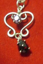 STERLING SILVER GARNET AND AMETHYST HEART PENDANT WITH A 20 INCH CHAIN