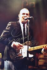 Original hand signed photo of Francis Rossi 10.7 x 8 in mounted by Mel Longhurst