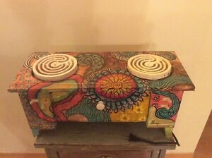 Unique vintage funtional metal table top stove.