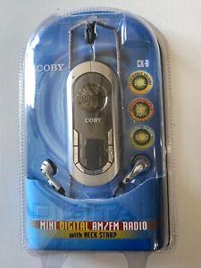 Coby CX-9 Silver & Blue Mini Digital AM/FM Radio with Neck Strap & Ear Buds -NIP