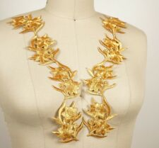 Embroider metallic flower gold.