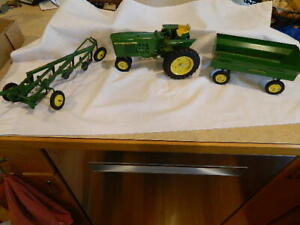 VINTAGE JOHN DEERE TRACTOR, WAGON and 4 BOTTOM PLOW