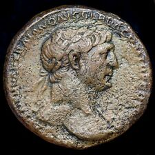 Trajan, 98-117 A.D. Dupondius. Roma Holding Victory, Seated On Trophy. 27mm.