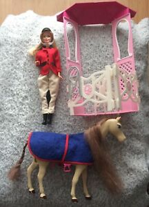 Barbie doll with horse and mini stable