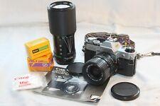 Canon AE-1 chrome film camera body w/ 35-70mm & 70-210mm lenses, film & more!