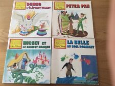 Lot de 4 LIVRES *LE MONDE ENCHANTÉ DE WALT DISNEY . collection hachette