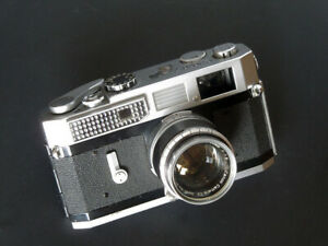 APPAREIL PHOTO 24X36 TELEMETRIQUE CANON 7 circa 1962