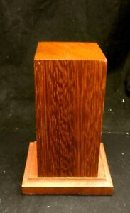 Wooden plinth surface area 50mm x 40mm. 95mm tall