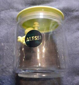 A di Alessi Gianni Glass Hanging Man Jar. Yellow/Lime Green Lid.
