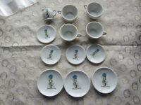 "Child's Tea Set Made in Japan. 12 Pcs. Blue Bonnet Girl ""Sharing is Caring"" #807"