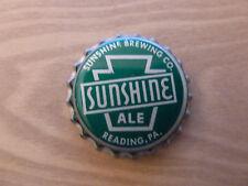 One vintage unused Sunshine Ale cork-lined beer bottle cap.