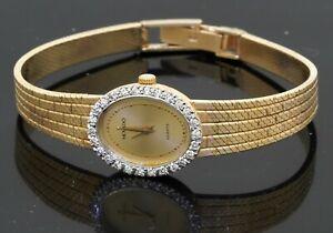 Movado vintage heavy 14K YG 0.52CT VS1/F diamond bezel ladies quartz watch