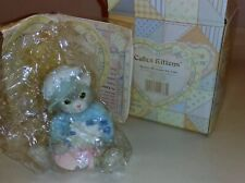 Enesco Calico Cats figurine of girl cat with blue flowers 102547