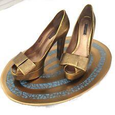 879b9304d484 Louis Vuitton Gold Bow Pumps Size 37.5