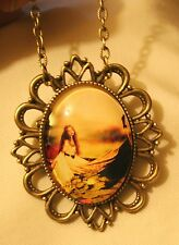 Festooned Brasstone Lovely Lady in Boat Lily Blossoms Pendant Necklace Brooch