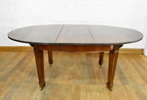 Antique style pull out extending dining table