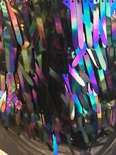 Iridescent Black, Purple Sword Shape Sequin On Black Mesh Fabric Sold By  Yard
