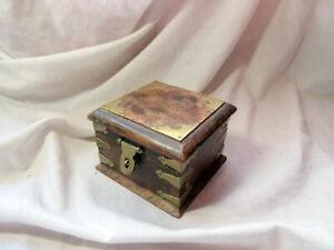 A VINTAGE BRASS AND WOOD SQUARE BOX