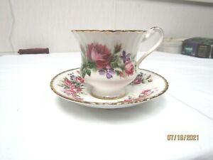PARAGON VINTAGE ENGLISH BONE CHINA CUP AN SAUCER. PINK ROSE W/PURPLE FLOWER