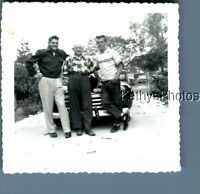 FOUND B&W PHOTO A_9077 MEN POSED IN FRONT OF OLD CAR IN DRIVEWAY
