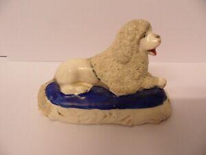 Staffordshire Recumbent Poodle Dog