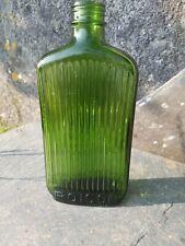 More details for large green ribbed antique poison bottle