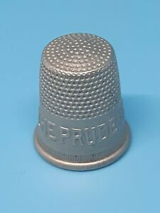 """EMBOSSED METAL ADVERTISING SEWING  THIMBLE """"THE PRUDENTIAL LIFE INSURANCE CO."""""""