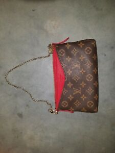 Authentic Louise Vuitton Purse on gold colored chain. Pre owned, good condition.
